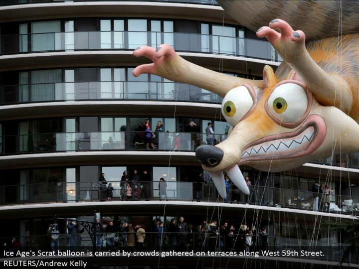 Ice Age's Scrat inflatable is conveyed by group accumulated on patios along West 59th Street. REUTERS/Andrew Kelly