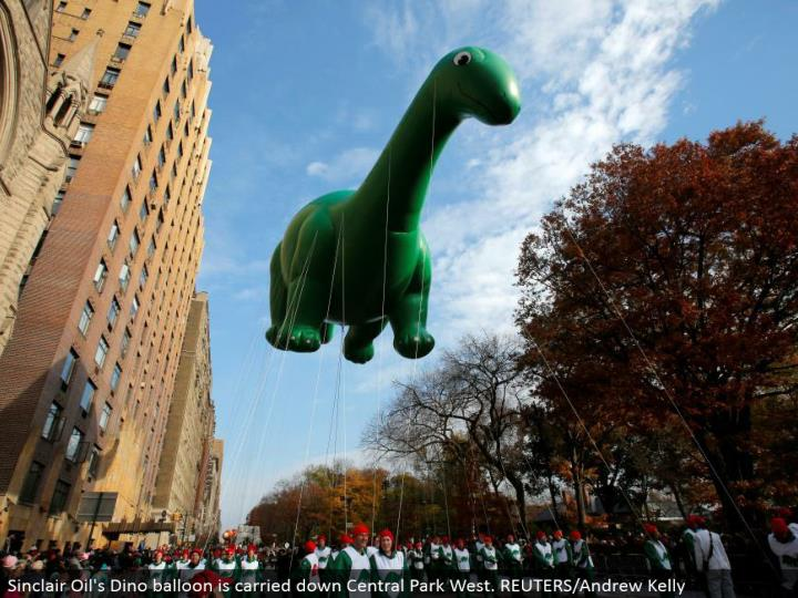 Sinclair Oil's Dino inflatable is conveyed down Central Park West. REUTERS/Andrew Kelly