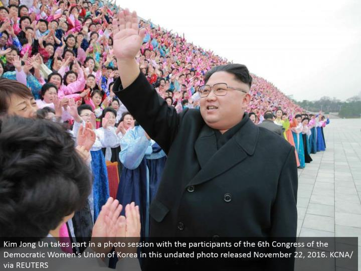 Kim Jong Un partakes in a photograph session with the members of the sixth Congress of the Democratic Women's Union of Korea in this undated photograph discharged November 22, 2016. KCNA/through REUTERS