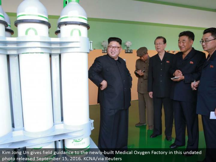 Kim Jong Un gives field direction to the recently assembled Medical Oxygen Factory in this undated p...