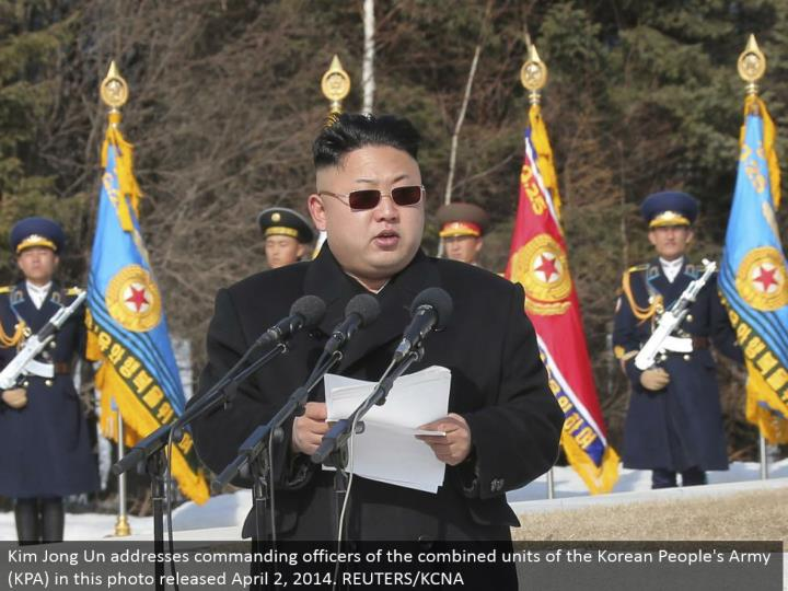 Kim Jong Un addresses bosses of the consolidated units of the Korean People's Army (KPA) in this photograph discharged April 2, 2014. REUTERS/KCNA