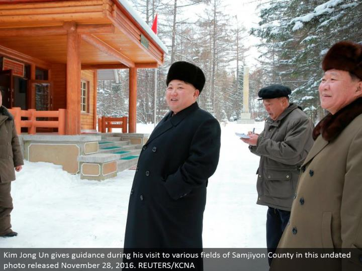 Kim Jong Un gives direction amid his visit to different fields of Samjiyon County in this undated ph...
