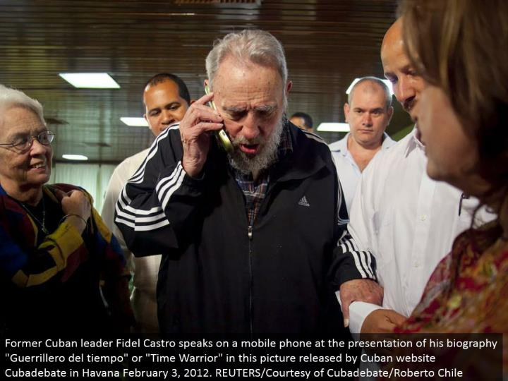 "Former Cuban pioneer Fidel Castro talks on a cell phone at the presentation of his life story ""Guerrillero del tiempo"" or ""Time Warrior"" in this photo discharged by Cuban site Cubadebate in Havana February 3, 2012. REUTERS/Courtesy of Cubadebate/Roberto Chile"