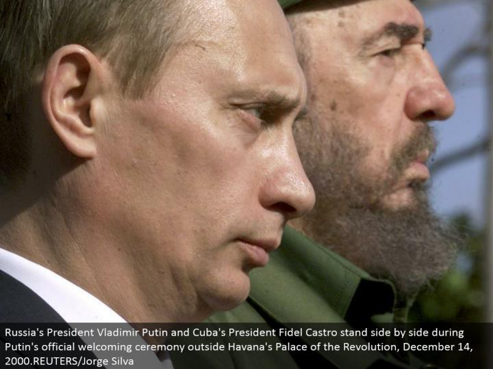 Russia's President Vladimir Putin and Cuba's President Fidel Castro stand next to each other amid Putin's authentic inviting service outside Havana's Palace of the Revolution, December 14, 2000.REUTERS/Jorge Silva