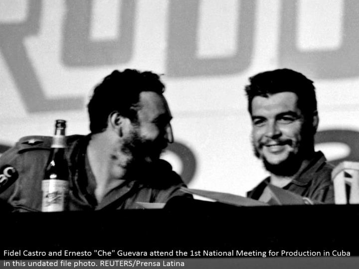 "Fidel Castro and Ernesto ""Che"" Guevara go to the first National Meeting for Production in Cuba in this undated record photograph. REUTERS/Prensa Latina"