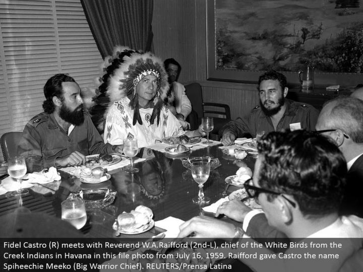 Fidel Castro (R) meets with Reverend W.A.Raifford (second L), head of the White Birds from the Creek Indians in Havana in this document photograph from July 16, 1959. Raifford gave Castro the name Spiheechie Meeko (Big Warrior Chief). REUTERS/Prensa Latina