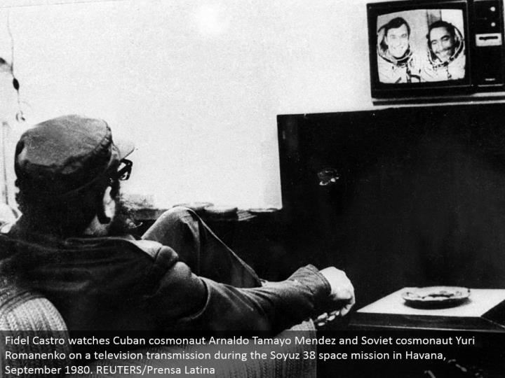 Fidel Castro watches Cuban cosmonaut Arnaldo Tamayo Mendez and Soviet cosmonaut Yuri Romanenko on a TV transmission amid the Soyuz 38 space mission in Havana, September 1980. REUTERS/Prensa Latina