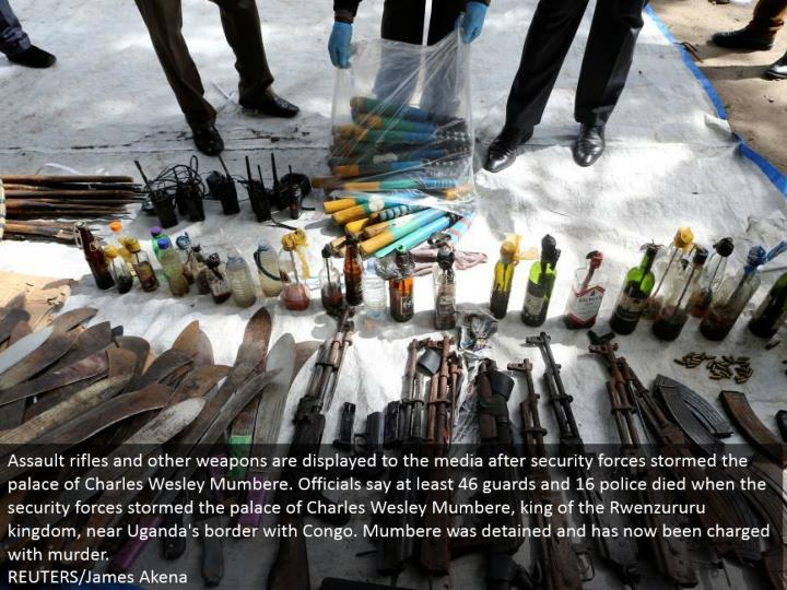 Assault rifles and different weapons are shown to the media after security powers raged the royal re...