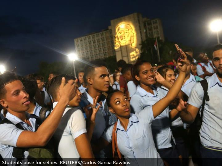 Students posture for selfies. REUTERS/Carlos Garcia Rawlins