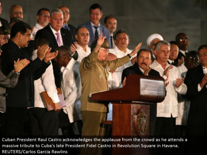 Cuban President Raul Castro recognizes the commendation from the group as he goes to a huge tribute to Cuba's late President Fidel Castro in Revolution Square in Havana. REUTERS/Carlos Garcia Rawlins
