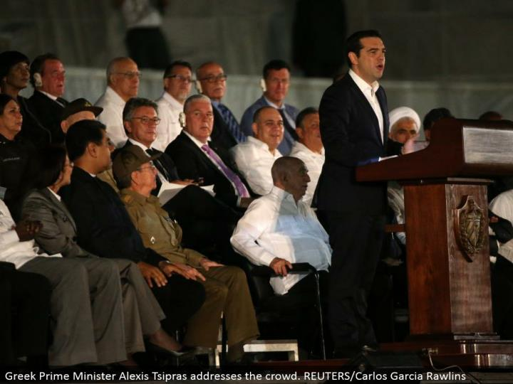 Greek Prime Minister Alexis Tsipras addresses the group. REUTERS/Carlos Garcia Rawlins