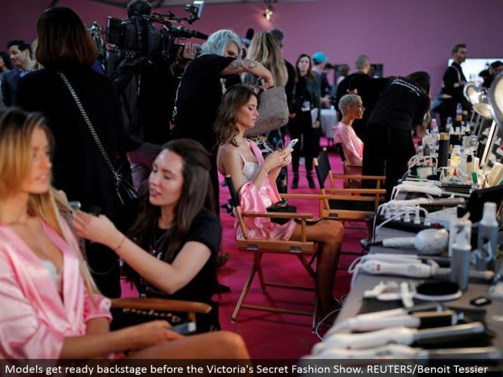 Models prepare backstage before the Victoria's Secret Fashion Show. REUTERS/Benoit Tessier