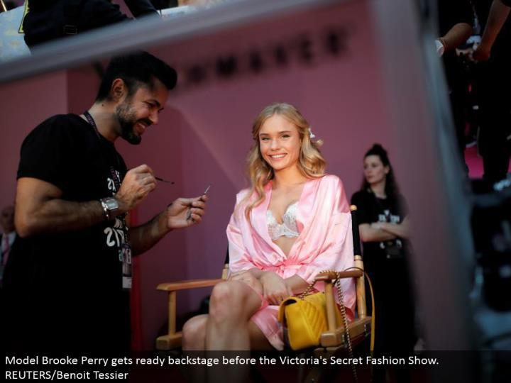 Model Brooke Perry prepares backstage before the Victoria's Secret Fashion Show. REUTERS/Benoit Tessier