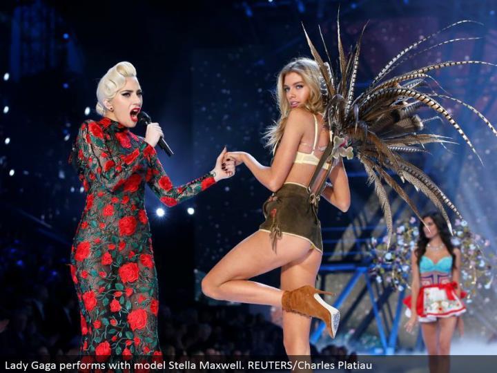 Lady Gaga performs with model Stella Maxwell. REUTERS/Charles Platiau