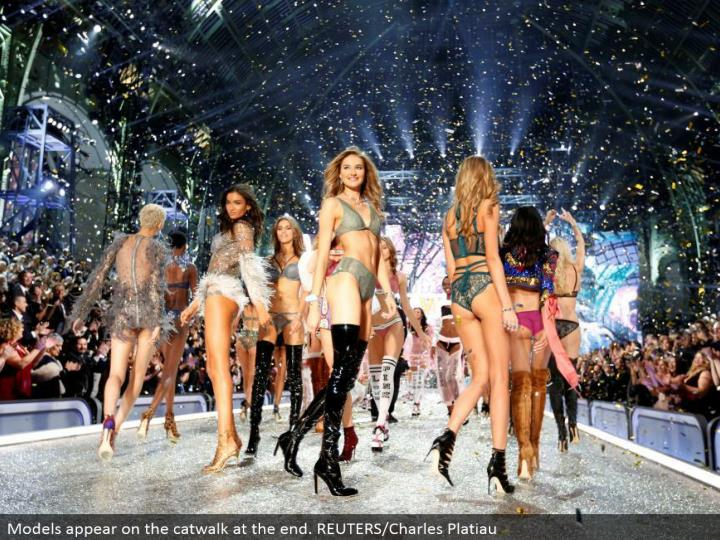Models show up on the catwalk toward the end. REUTERS/Charles Platiau