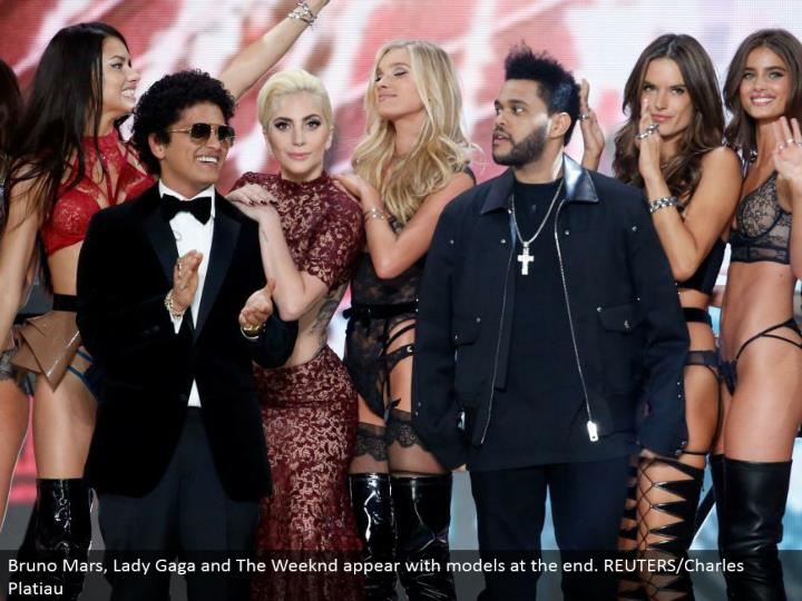 Bruno Mars, Lady Gaga and The Weeknd show up with models toward the end. REUTERS/Charles Platiau