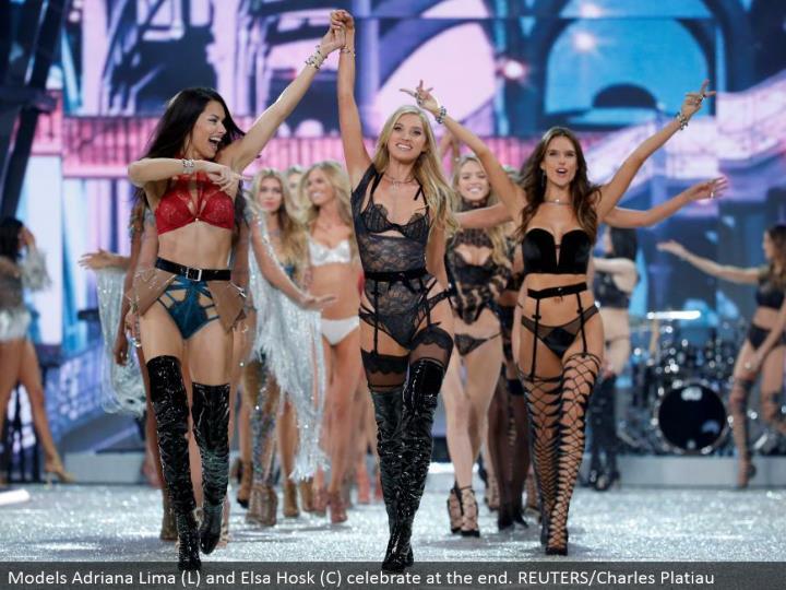 Models Adriana Lima (L) and Elsa Hosk (C) celebrate toward the end. REUTERS/Charles Platiau