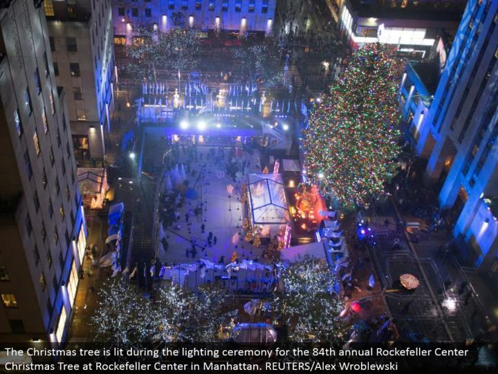 The Christmas tree is lit amid the lighting function for the 84th yearly Rockefeller Center Christmas Tree at Rockefeller Center in Manhattan. REUTERS/Alex Wroblewski
