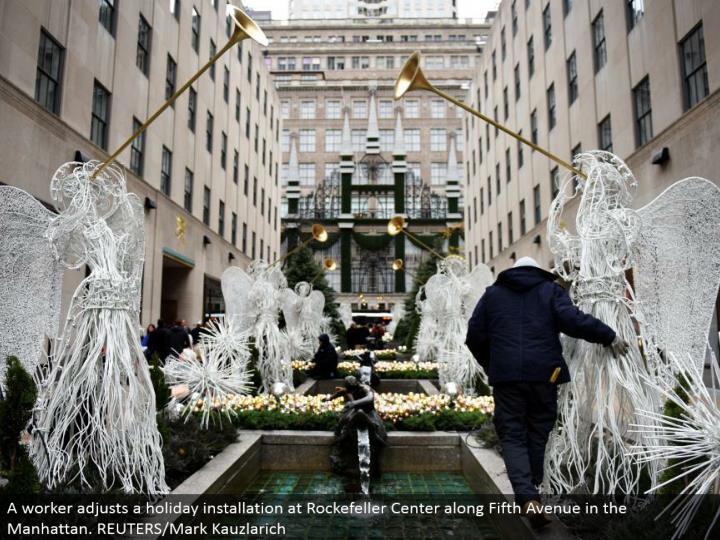 A laborer conforms an occasion establishment at Rockefeller Center along Fifth Avenue in the Manhattan. REUTERS/Mark Kauzlarich