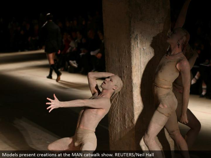 Models display manifestations at the MAN catwalk appear. REUTERS/Neil Hall