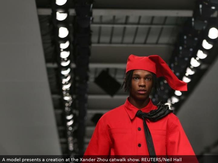 A demonstrate presents a creation at the Xander Zhou catwalk appear. REUTERS/Neil Hall