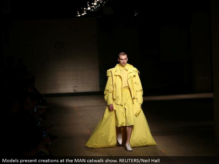 Models exhibit manifestations at the MAN catwalk appear. REUTERS/Neil Hall