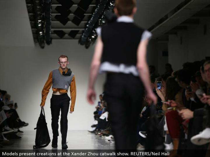Models display manifestations at the Xander Zhou catwalk appear. REUTERS/Neil Hall