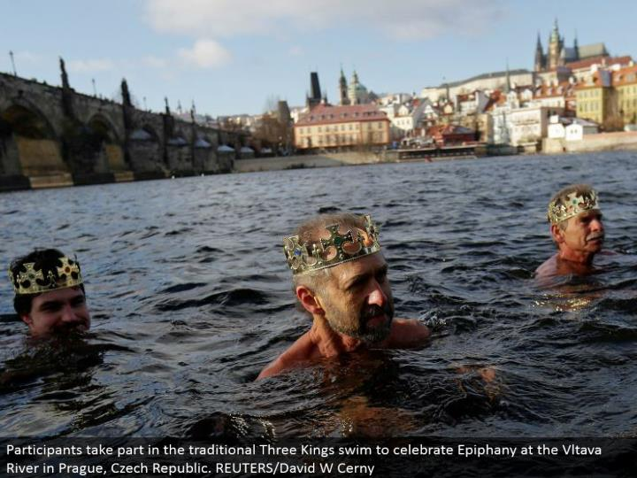 Participants partake in the customary Three Kings swim to observe Epiphany at the Vltava River in Prague, Czech Republic. REUTERS/David W Cerny
