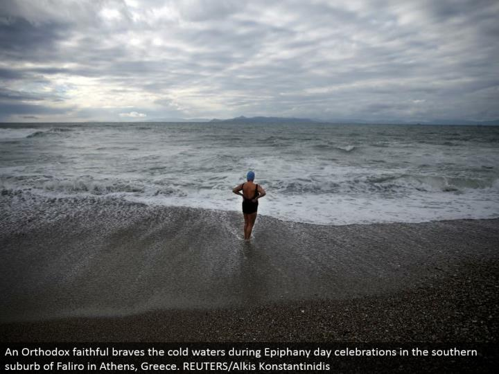 An Orthodox dependable overcomes the icy waters amid Epiphany day festivities in the southern suburb of Faliro in Athens, Greece. REUTERS/Alkis Konstantinidis
