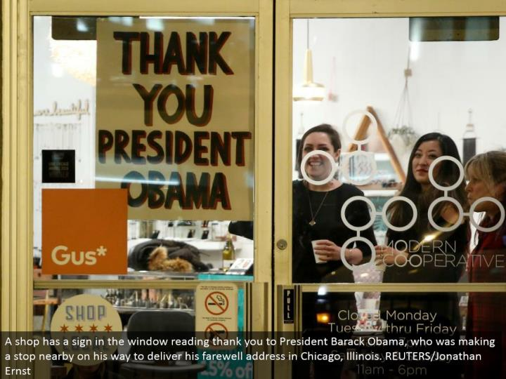 A shop has a sign in the window perusing thank you to President Barack Obama, who was making a stop close-by on his approach to convey his goodbye address in Chicago, Illinois. REUTERS/Jonathan Ernst