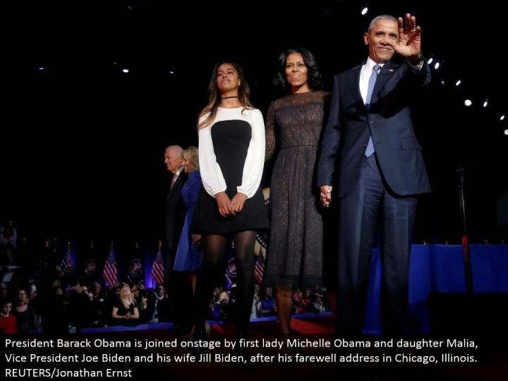 President Barack Obama is joined in front of an audience by first woman Michelle Obama and little girl Malia, Vice President Joe Biden and his better half Jill Biden, after his goodbye address in Chicago, Illinois. REUTERS/Jonathan Ernst