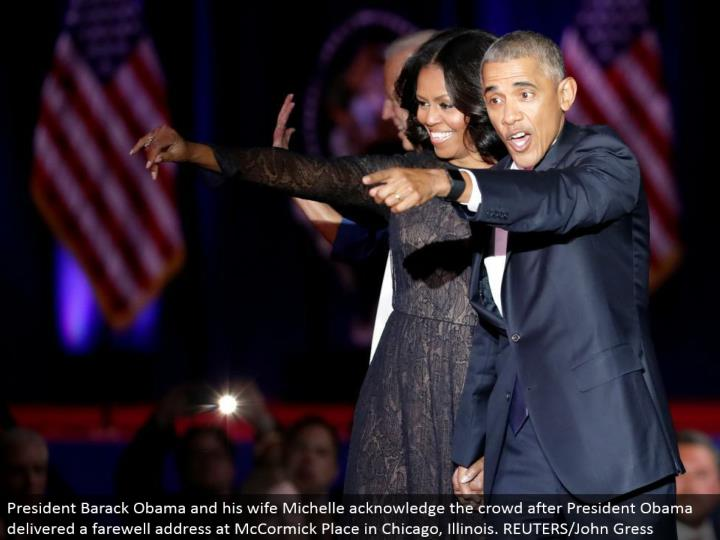 President Barack Obama and his better half Michelle recognize the group after President Obama conveyed a goodbye address at McCormick Place in Chicago, Illinois. REUTERS/John Gress