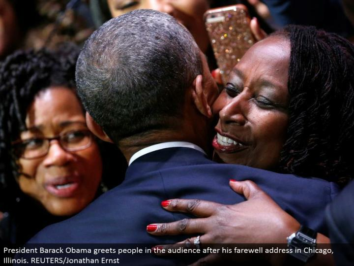President Barack Obama welcomes individuals in the gathering of people after his goodbye address in Chicago, Illinois. REUTERS/Jonathan Ernst