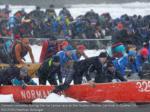 canoers contend amid the ice canoe race