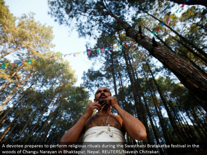 A lover plans to perform religious customs amid the Swasthani Bratakatha celebration in the forested areas of Changu Narayan in Bhaktapur, Nepal. REUTERS/Navesh Chitrakar