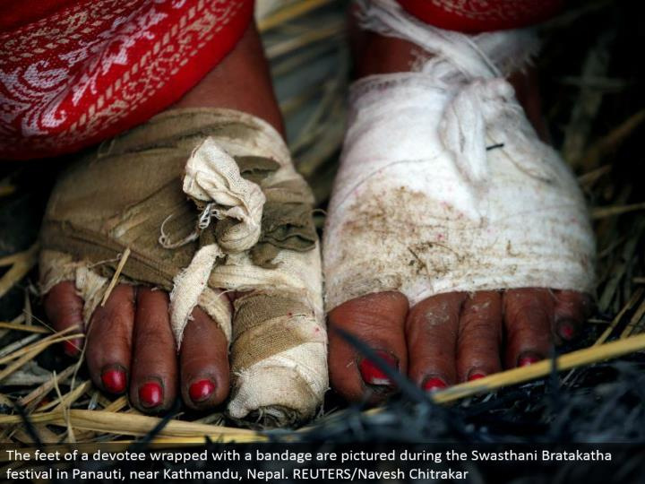 The feet of a lover wrapped with a gauze are envisioned amid the Swasthani Bratakatha celebration in Panauti, close Kathmandu, Nepal. REUTERS/Navesh Chitrakar