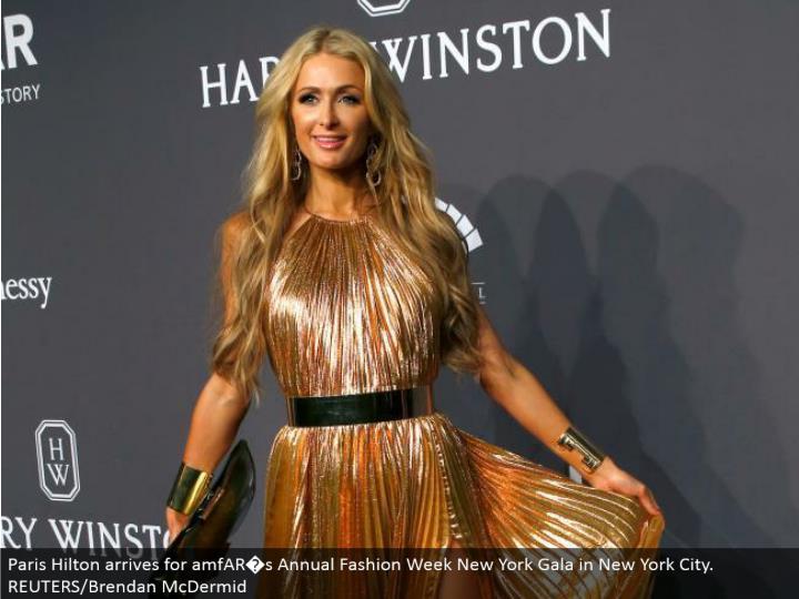 Paris Hilton touches base for amfAR�s Annual Fashion Week New York Gala in New York City. REUTERS/Brendan McDermid
