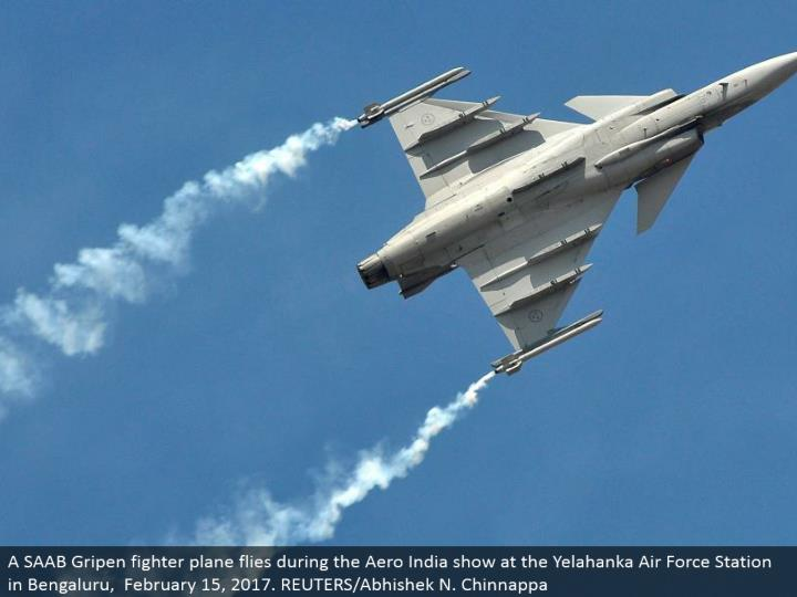 A saab gripen military aircraft flies amid