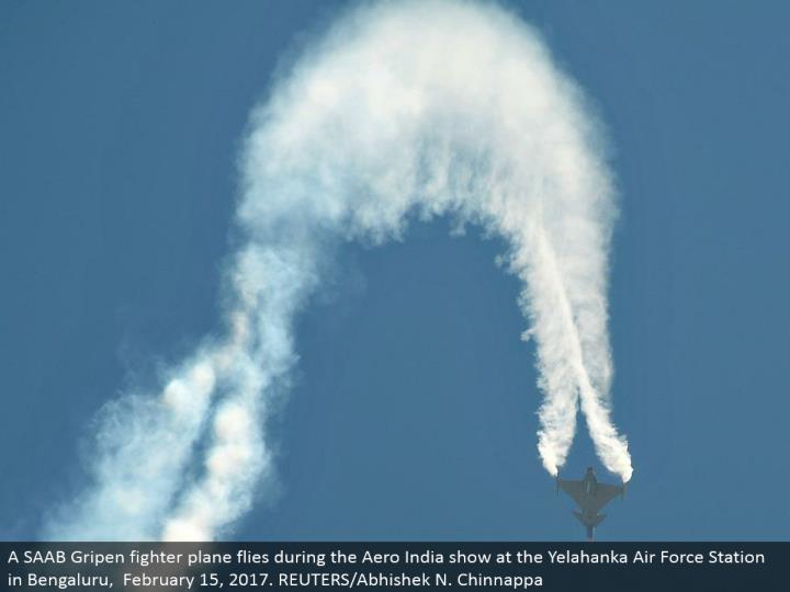 A saab gripen military aircraft flies amid1