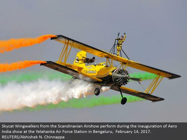 Skycat Wingwalkers from the Scandinavian Airshow perform amid the initiation of Aero India appear at the Yelahanka Air Force Station in Bengaluru, February 14, 2017. REUTERS/Abhishek N. Chinnappa