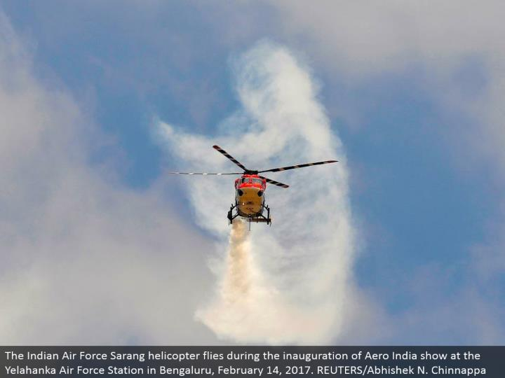 The Indian Air Force Sarang helicopter flies amid the initiation of Aero India appear at the Yelahanka Air Force Station in Bengaluru, February 14, 2017. REUTERS/Abhishek N. Chinnappa