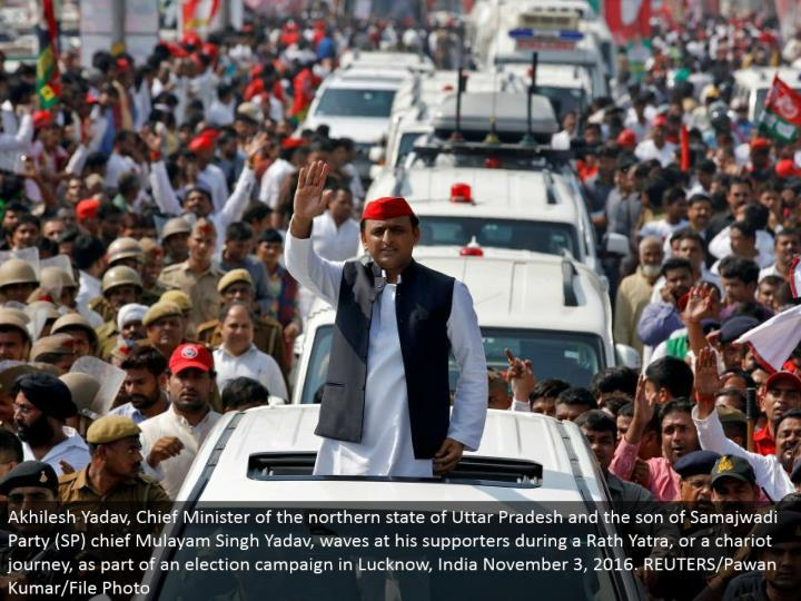 Akhilesh Yadav, Chief Minister of the northern condition of Uttar Pradesh and the child of Samajwadi Party (SP) boss Mulayam Singh Yadav, waves at his supporters amid a Rath Yatra, or a chariot travel, as a component of a decision battle in Lucknow, India November 3, 2016. REUTERS/Pawan Kumar/File Photo