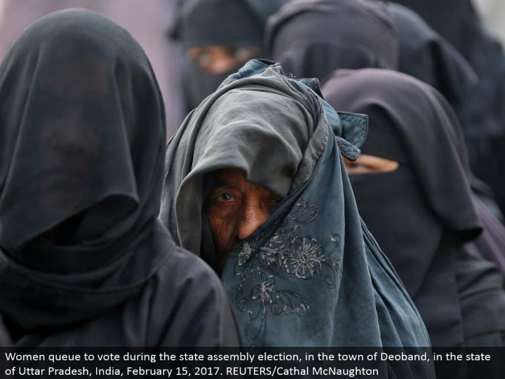 Women line to vote amid the state gathering race, in the town of Deoband, in the condition of Uttar Pradesh, India, February 15, 2017. REUTERS/Cathal McNaughton