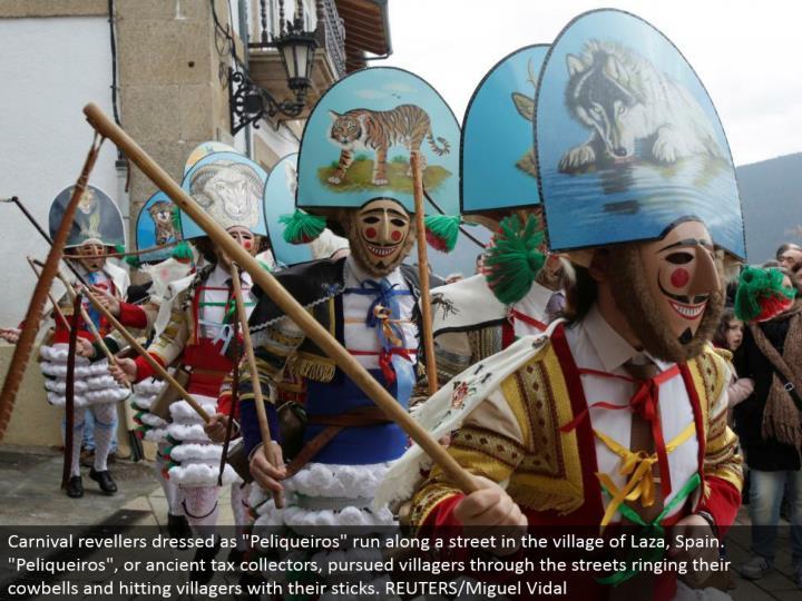 Carnival revelers dressed as peliqueiros keep