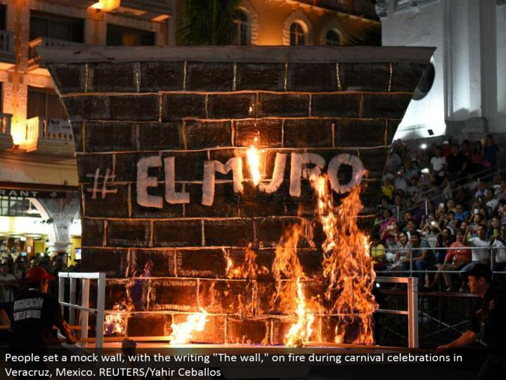 "People set a deride divider, with the written work ""The divider,"" ablaze amid jamboree festivities in Veracruz, Mexico. REUTERS/Yahir Ceballos"