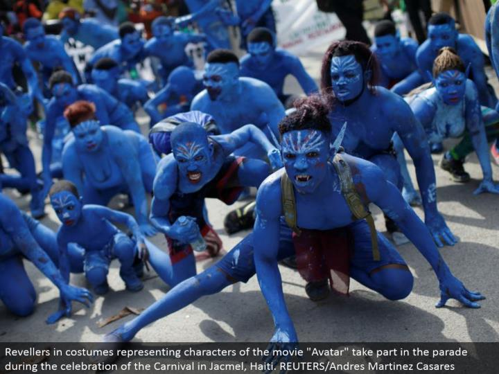 """Revellers in outfits speaking to characters of the motion picture """"Symbol"""" partake in the parade amid the festival of the Carnival in Jacmel, Haiti. REUTERS/Andres Martinez Casares"""