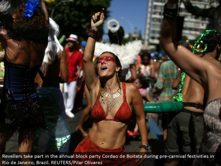 Revellers partake in the yearly piece party Cordao de Boitata amid pre-fair celebrations in Rio de Janeiro, Brazil. REUTERS/Pilar Olivares