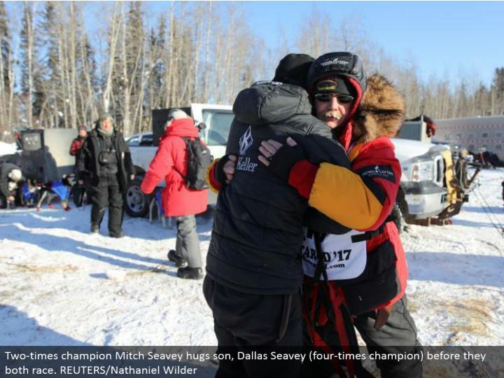 Two-times champion Mitch Seavey embraces child, Dallas Seavey (four-times champion) before they both race. REUTERS/Nathaniel Wilder