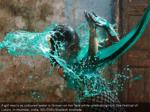 a young lady responds as hued water is tossed