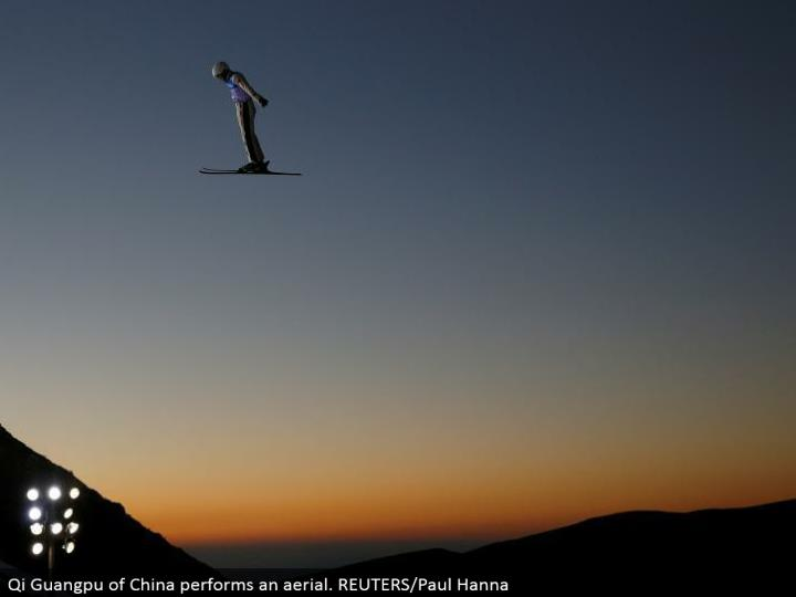 Qi Guangpu of China plays out a flying. REUTERS/Paul Hanna